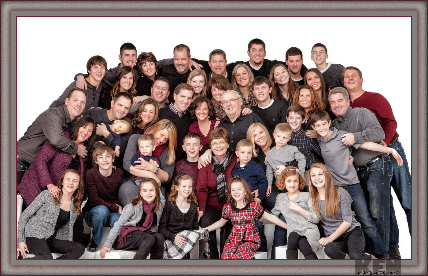 Fourty (40) people comfortably posed for a family grouping in the studio. Specialists in large family groups.