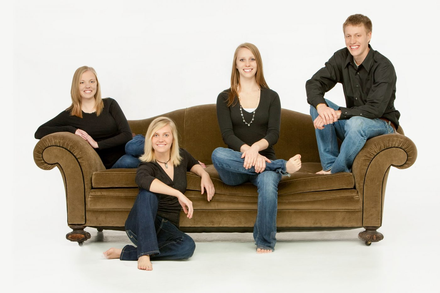 4 sibs on a couch playing musical chairs