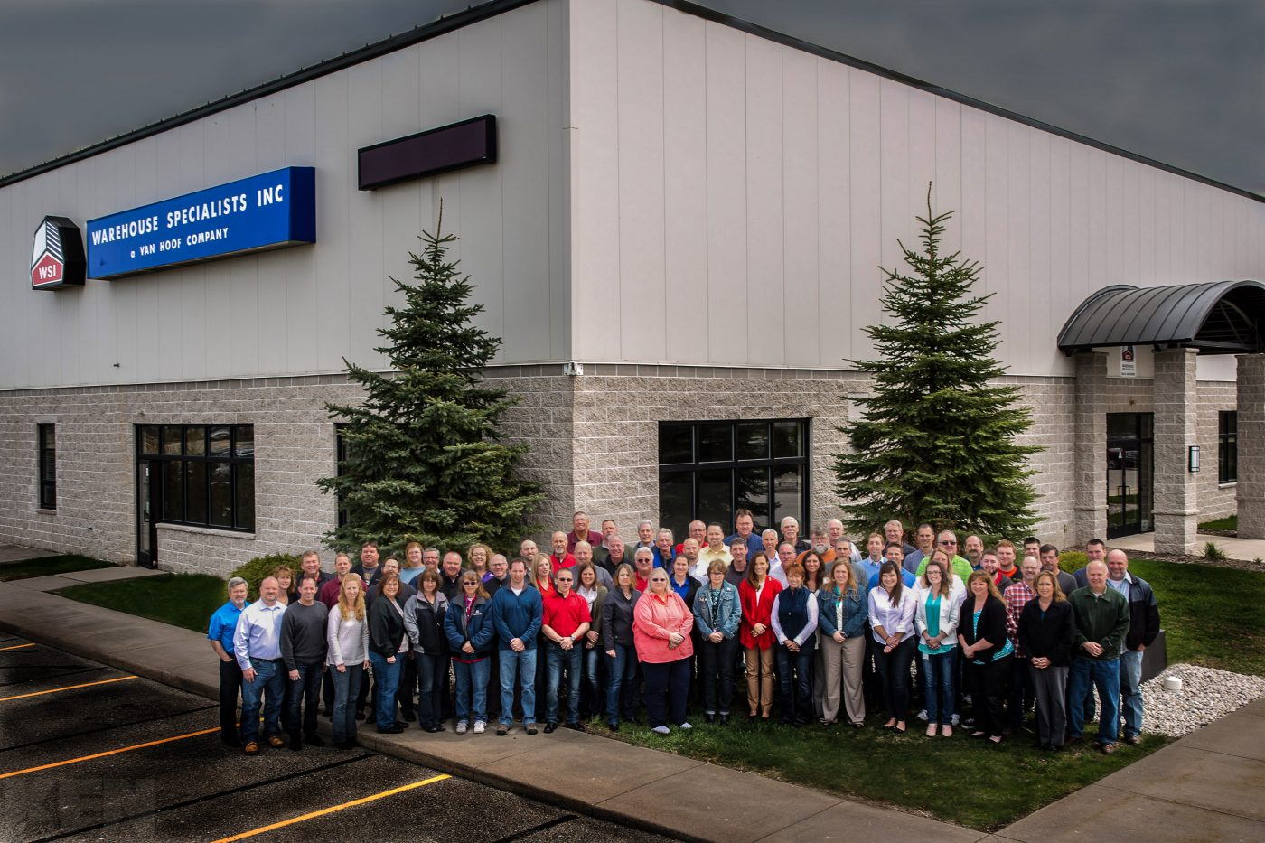 Large group portrait of the Warehouse Specialists Inc employees, at their warehouse in Appleton, Wisconsin.