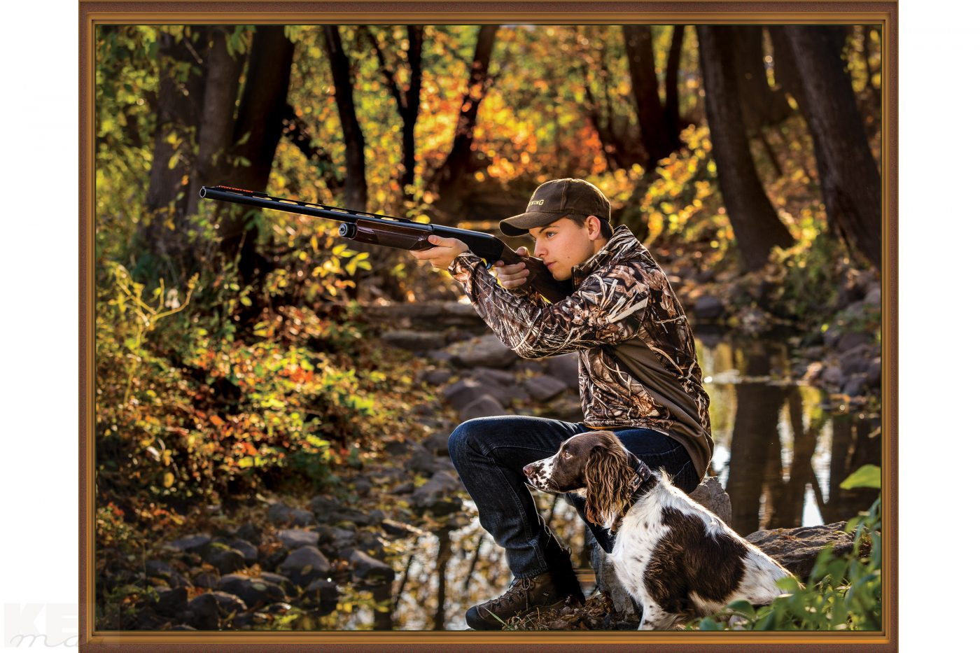 A boy, a dog, a gun, hunting.